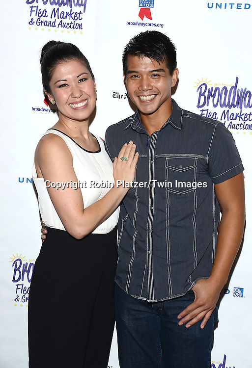 Ruthie Ann Miles and Telly Leung attend the 28th Annual  Broadway Cares/ Equity Fights Aids Flea Market and Auction on September 21,2014 in Shubert Alley in New York City. <br /> <br /> photo by Robin Platzer/Twin Images<br />  <br /> phone number 212-935-0770