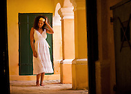 A woman walks barefoot through an old fort in St. Croix, US Virgin Islands