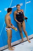 26 JUL 2012 - LONDON, GBR - Diver Tom Daley (GBR) talks with Great Britain team mate Tonia Couch (GBR) as they shower after finishing their practice sessions at the Aquatics Centre in the Olympic Park in Stratford, London, Great Britain ahead of the start of the London 2012 Olympic Games (PHOTO (C) 2012 NIGEL FARROW)