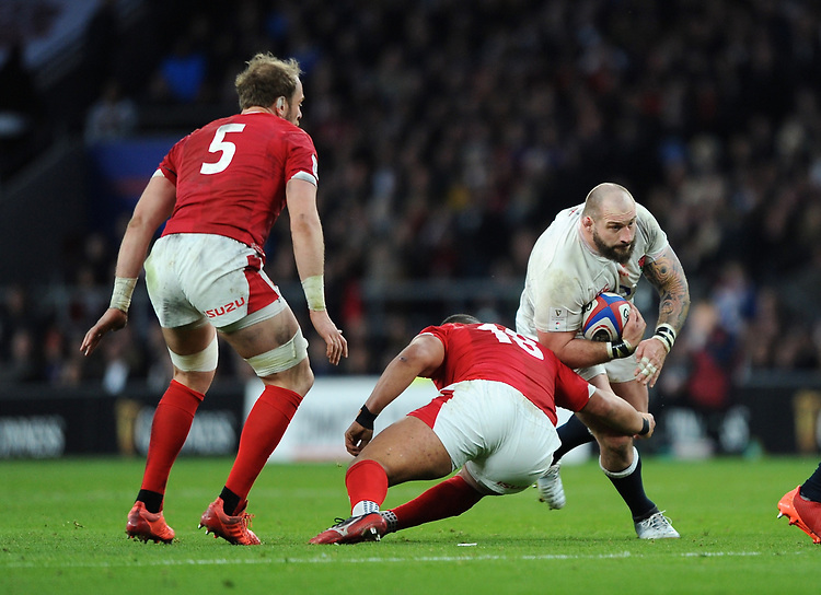 Joe Marler of England is tackled by Leon Brown of Wales during the Guinness Six Nations match between England and Wales at Twickenham Stadium on Saturday 7th March 2020 (Photo by Rob Munro/Stewart Communications)