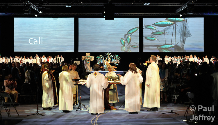 Bishops surround the communion table during the opening worship celebration of the United Methodist General Conference in Tampa, Florida.