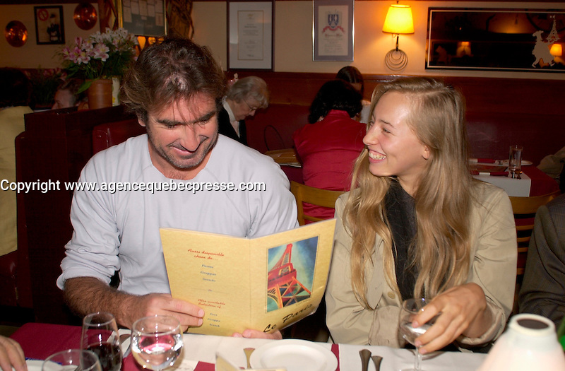 Sept 1,  2003, Montreal, Quebec, Canada<br /> <br /> Eric Cantona, actor - L'OUTREMANGEUR (THE OVEREATER) (L) and Isild Le Besco, Actress (R)<br /> check out the menu, at a private dinner during the Montreal World Film Festival, Sept 1 2003<br /> <br /> The Festival runs from August 27th to september 7th, 2003<br /> <br /> <br /> Mandatory Credit: Photo by Pierre Roussel- Images Distribution. (&copy;) Copyright 2003 by Pierre Roussel <br /> <br /> All Photos are on www.photoreflect.com, filed by date and events. For private and media sales