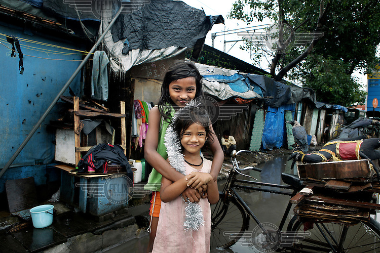 Two girls living in a slum surrounding Reay Rd Railway station. In Mumbai, India's financial capital,  half the population live in slums.  The slum growth rate is actually greater than the general urban growth rate and the city is nicknamed Slumbay...
