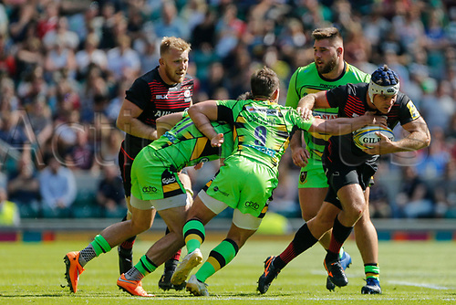 2nd September 2017, Twickenham, London, England; Aviva Premiership Rugby, Saracens versus Northampton;  Schalk Brits of Saracens is tackled by Nic Groom of Northampton Saints