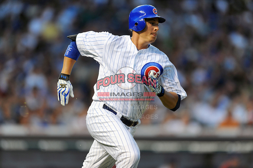 Chicago Cubs right fielder Bryan LaHair #6 runs to first during a game against the Miami Marlins at Wrigley Field on July 17, 2012 in Chicago, Illinois. The Marlins defeated the Cubs 9-5. (Tony Farlow/Four Seam Images).