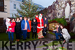 Waterville lights up for Christmas pictured here volunteers and sponsors of the Community Christmas Tree and Grotto l-r; Aneka Hitmiangsong, Marita Hitmiangsong, Margaret Galvin, Pat Ahern, Fiona Fitzpatrick, Dawn O'Sullivan, Anne Ahern, Santa(David Galvin), Alan McGuirk, Sheila Anne Fogarty, Bridie Moran & Trish O'Sullivan