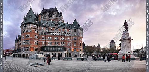 Panoramic scenery of Fairmont Le Château Frontenac at dusk with dramatic sky, luxury grand hotel Chateau Frontenac, National Historic Site of Canada. Old Quebec City, Quebec, Canada. Ville de Québec.