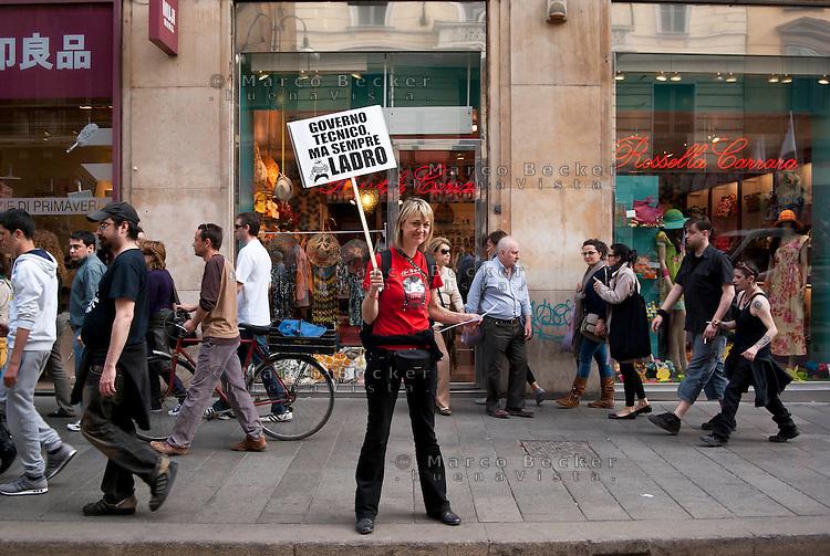 """Milano, """"Occupyamo Piazza Affari"""", manifestazione di protesta di partiti e organizzazioni di estrema sinistra contro la crisi economica e i provvedimenti messi in atto dal governo --- Milan, """"Occupy Piazza Affari"""", demonstration of  extreme left parties and organizations to protest against the  economic crisis and the Government"""