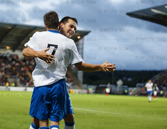 Andy Little and Chris Hegarty start to dance