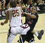 Lincoln's Anthony Hagger is fouled by Central Catholic's Andy Clark in the Cardinals' 59-50 win over the Rams in the semifinals of the 6A state boys championship at McArthur Court Friday, March 13, 2009.