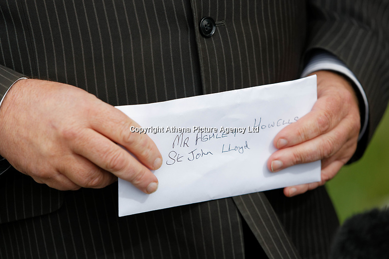 """Pictured: Byron John  the father of Bradley John with the letter he delivered to St John Lloyd School in Llanelli, Wales, UK. Friday 21 September 2018<br /> Re: The grieving father of a bullied pupil who hanged himself in school toilets is calling for the headteacher's resignation.<br /> Heartbroken Byron John claims his son Bradley, 14, would still be alive if the school had acted to stop the bullies.<br /> Mr John, 53, will hand in a formal letter of complaint to the school today (Fri) demanding head Ashley Thomas resigns.<br /> Bradley's 12-year-old sister Danielle found him dead in the toilet block at St John Lloyd Roman Catholic School in Llanelli, South Wales.<br /> Mr John claims his son had been missing for an hour before teachers refused to break down the door of the cubicle where the troubled teenager was found.<br /> Farmer Mr John said: """"I'm very unhappy at the way the school has handled things both before Bradley died, on the day it happened and since.<br /> """"There was a systematic failure of any workable anti-bullying policy.<br /> """"There was a failure to follow up our concerns and those of the healthcare professionals helping my son."""""""
