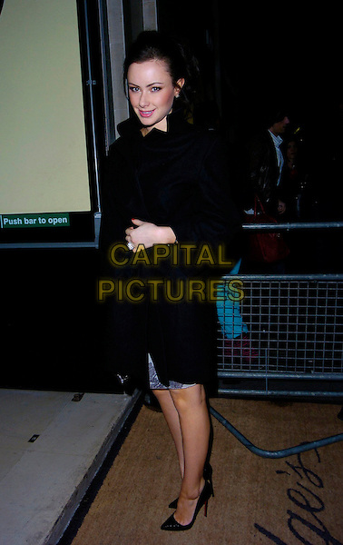 CAMILLA AL FAYED.At the Marc by Marc Jacobs a/w 2007/8 catwalk show,.Claridge's, London, England, February 16th 2007..full length black coat stilettoes shoes.CAP/CAN.©Can Nguyen/Capital Pictures