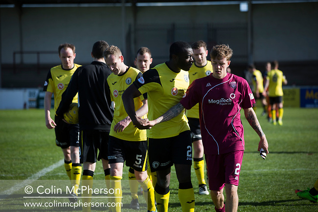 Visiting defender Joe Mbu has words with an opponent as the teams leave the pitch after the final whistle as Arbroath hosted Edinburgh City (in yellow) in an SPFL League 2 fixture. The newly-promoted side from the Capital were looking to secure their place in SPFL League 2 after promotion from the Lowland League the previous season. They won the match 1-0 with an injury time goal watched by 775 spectators to keep them 4 points clear of bottom spot with three further games to play.