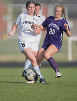 NWA Democrat-Gazette/J.T. WAMPLER Fayetteville's Myra Tubb and Bentonville's Madison Howard fight for the ball Friday April 14, 2017 at Bentonville. The Tigers won 1-0 and are 8-0 for the season.