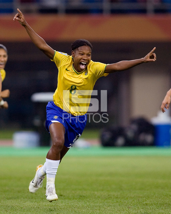Brazil forward (8) Formiga celebrates her goal during the quarterfinals of the FIFA Women's World Cup at Tianjin Olympic Center Stadium in Tianjin, China.  Brazil defeated Australia, 3-2.