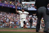 SAN FRANCISCO, CA - SEPTEMBER 29:  Hunter Pence #8 of the San Francisco Giants slides home safely against the Los Angeles Dodgers during the game at AT&T Park on Saturday, September  29, 2018 in San Francisco, California. (Photo by Brad Mangin)