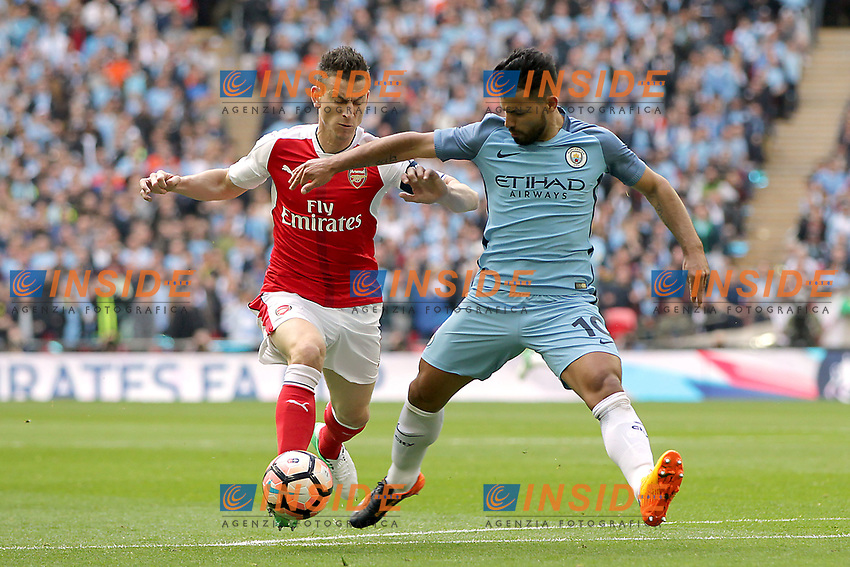 Sergio Aguero of Manchester City under pressure from Laurent Koscielny of Arsenal<br /> London 23/04/2017 <br /> Arsenal vs Manchester City - FA Cup Semi Final <br /> Foto Darren Staples/PHCImages / Panoramic/Insidefoto <br /> ITALY ONLY