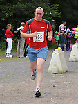 Ollie McHugh finishes the Slane 10 Mile run as part of the Ladywell Fete held in the grounds of Slane castle. Photo: www.pressphotos.ie