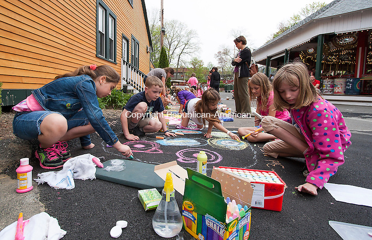 MIDDLEBURY, CT - 09 APRIL 2015 - 050915JW09.jpg -- Middlebury Elementary 3rd grade students Maya Alhabbal, Ciaran Flanagan, Natalie DuVerger, Kate Kennon and Mary Grace Styble take part in the Quassy Amusement Park's Chalk Drawing Day Saturday afternoon. Jonathan Wilcox Republican-American