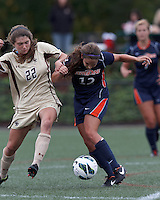 Pepperdine University defender Kristin DeGrandmont (12) passes the ball as Boston College defender McKenzie Meehan (22) defends. Pepperdine University defeated Boston College,1-0, at Soldiers Field Soccer Stadium, on September 29, 2012.