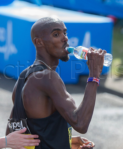 07.09.2014.  South Shields, England.  BUPA Great North Run. Mo Farah takes on some liquids after his first place in the Great North Run.