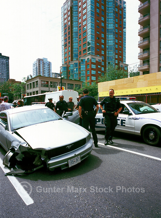 Police Investigation - Officers investigate Damaged Car at Road Traffic Accident Scene, Vancouver, BC, British Columbia, Canada