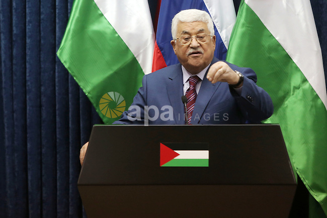 Palestinian President Mahmoud Abbas speaks during a joint news conference with Russian Prime Minister Dmitry Medvedev in the West Bank city of Jericho November 11, 2016. Photo by Shadi Hatem