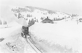 Light engine with boxcars at Cumbres station in deep snow cut.<br /> D&amp;RGW  Cumbres, CO