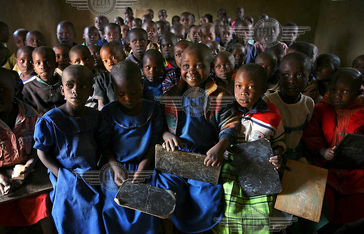 Children at the Bweyeye School in the isolated village of Bweyeye in Cyangugu, where Rwanda Aid has provided equipment such as desks, chairs, exercise books, pens and extra classrooms.