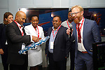 DURBAN - 2 September 2016 - The chief executive of Transnet National Ports Authority, Richard Valihu, opens a present received from representatives of Royal IHC at the unveiling of a R29 million dredging simulator. looking on from left are head of economic affairs at the Netherlands embassy in South Africa Tineke Mulder, the chief human resources officer at TNPA Nonkululeko Sishi, the head of TNPA's dredging services Carl Gabriel, and unknown journalist and Bert-Jan de keijzer, the manager of supplier development for the Dutch firm Royal IHV (holding microphone)  Picture: Allied Picture Press/APP