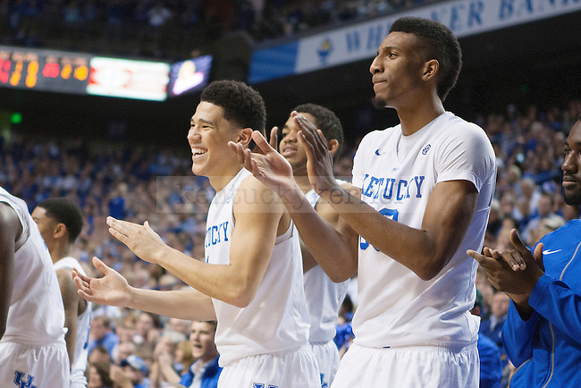 Guard Devin Booker and center Marcus Lee of the Kentucky Wildcats celebrate a dunk during the second half of the game against the Providence Friars at Rupp Arena on Sunday, November 30, 2014 in Lexington, Ky. Kentucky defeated Providence 58-38. Photo by Michael Reaves | Staff
