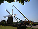 07/06/16<br /> <br /> ***With Video:   https://youtu.be/6A5HVYjOzms ****<br /> <br /> The sails are finally turning again on Britain's only working six-sailed stone windmill, in Heage near Belper, Derbyshire after a huge crane hoisted them into position yesterday.<br /> <br /> The six sails were removed in November 2015 to allow restoration work to be carried out over winter, after wet rot was discovered in the beams supporting the sails at Heage Windmill last summer.<br /> <br /> As well as replacing the supporting beams that stretch as far as the mill's fantail, the sails and windmill &lsquo;cap&rsquo; have also been restored and painted by a team of volunteers.<br /> <br /> The cost of around &pound;80,000 to carry out the essential repairs has been donated by local businesses and through the efforts of numerous fund-raising initiatives by the volunteer team. <br /> <br /> The windmill first ran in 1797 and continued to mill commercially until it was struck by lightning in 1919.<br /> <br /> It still produces small batches of wholemeal flour, stoneground from British wheat harvested in a traditional way, in a natural environment free from synthetic fertilisers and pesticides.<br /> <br /> All Rights Reserved: F Stop Press Ltd. +44(0)1335 418365   www.fstoppress.com Timelapse with voiceover here:   <br />