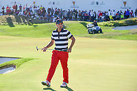 Kevin Kisner (USA) reacts to barely missing is putt on 14 during round 4 Singles of the 2017 President's Cup, Liberty National Golf Club, Jersey City, New Jersey, USA. 10/1/2017. <br /> Picture: Golffile | Ken Murray<br /> <br /> All photo usage must carry mandatory copyright credit (&copy; Golffile | Ken Murray)