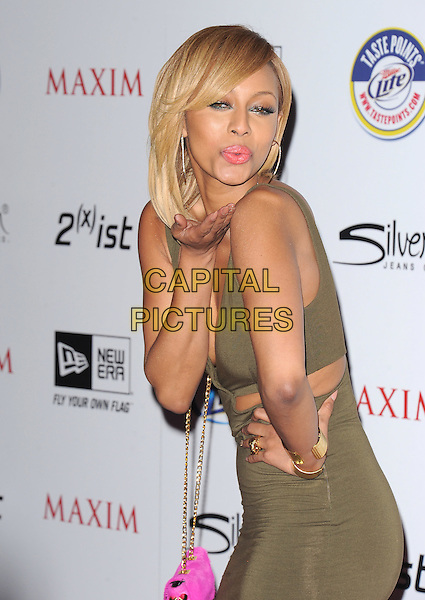 KERI HILSON.The MAXIM HOT 100 Party held at Eden in Hollywood, California, USA..May 11th, 2011         .half length dress green cut out away cleavage gold bracelets cuffs hand on hip side blowing kiss leaning .CAP/RKE/DVS.©DVS/RockinExposures/Capital Pictures.