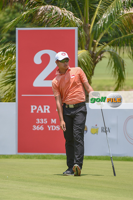 Lucius TOH (SIN) watches his tee shot on 2 during Rd 1 of the Asia-Pacific Amateur Championship, Sentosa Golf Club, Singapore. 10/4/2018.<br /> Picture: Golffile | Ken Murray<br /> <br /> <br /> All photo usage must carry mandatory copyright credit (© Golffile | Ken Murray)