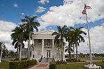 The Old Collier County Courthouse is designed in the classical revival style.