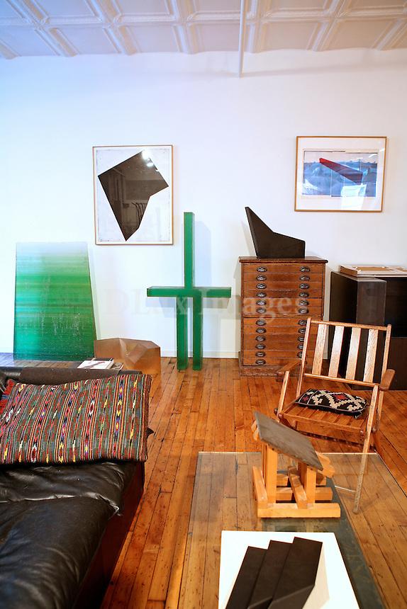 minimal living room with artworks
