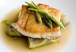 Seared Triple Tail with artichoke barigoule is a featured dish at the Reef restaurant. Bryan Caswell is the owner/chef of Reef restaurant at 2600 Travis, Suite 100.  Wednesday, June 6, 2007, in Houston. ( Steve Campbell / Chronicle)
