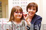 Theresa Tangney at Tangney's Opticians fits Aoife Clifford with a new pair of glasses out of the many styles and colour of Children glasses they have on offer