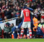 Arsenal's Mesut Ozil celebrates scoring his sides second goal with Mathieu Flamini<br /> <br /> Barclays Premier League - Arsenal vs Aston Villa - Emirates Stadium  - England - 1st February 2015 - Picture David Klein/Sportimage