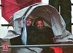 Wolcott, CT 11/26/98 1126jw05.98 Fans of the Crusaders try to keep dry while watching the Holy Cross vs Wolcott game Thanksgiving Day. Wolcott defeated Holy Cross 6-0. Jonathan Wilcox Standalone Photo.
