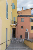 FRANCE, Menton in Cote d'Azur, Yellow and Orange two floor buildings with turquoise sgutters