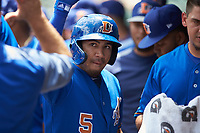 Kean Wong (5) of the Durham Bulls is congratulated by teammates after hitting a home run against the Charlotte Knights at BB&T BallPark on May 27, 2019 in Charlotte, North Carolina. The Bulls defeated the Knights 10-0. (Brian Westerholt/Four Seam Images)