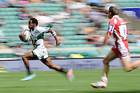 Carlin Isles of San Francisco Golden Gate accelerates away from Steph Reynolds of Gloucester Rugby 7s to score a try during the World Club 7s at Twickenham on Sunday 18th August 2013 (Photo by Rob Munro)