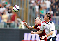 Calcio, Serie A: Roma vs Cagliari. Roma, stadio Olimpico, 21 settembre 2014.<br /> Roma midfielder Radja Nainggolan, of Belgium, and Cagliari midfielder Albin Ekdal, of Sweden, right, fight for the ball during the Italian Serie A football match between AS Roma and Cagliari at Rome's Olympic stadium, 21 September 2014.<br /> UPDATE IMAGES PRESS/Riccardo De Luca