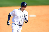 Detroit Tigers first baseman Don Kelly #32 runs the bases after hitting a home run during a Spring Training game against the Atlanta Braves at Joker Marchant Stadium on February 27, 2013 in Lakeland, Florida.  Atlanta defeated Detroit 5-3.  (Mike Janes/Four Seam Images)