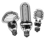 X-ray image of three compact fluorescent lamps (black on white) by Jim Wehtje, specialist in x-ray art and design images.