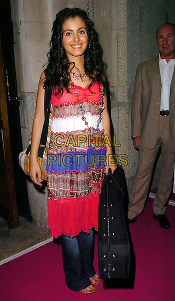 "KATIE MELUA.Attends the ""In The Pink"" Gala Reception at Cadogan Hall, London, in aid of Breast Cancer Haven..June 20th 2005..full length red white blue boho striped dress over trousers jeans necklace beads guitar case.Ref: CAN.www.capitalpictures.com.sales@capitalpictures.com.©Can Nguyen/Capital Pictures"
