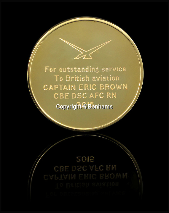 BNPS.co.uk (01202 558833)<br /> Pic: Bonhams/BNPS<br /> <br /> Eric Brown's Air League Founders Medal.<br /> <br /> The historic medals and logbooks of legendary test pilot Eric 'Winkle' Brown have been saved for the nation and will be displayed in a British museum.<br /> <br /> A deal has been secured for the hero's prestigious decorations and all his flying journals after they failed to sell at auction earlier this week.<br /> <br /> They had been expected to sell for &pound;200,000, possibly to an overseas buyer, but bidding only reached &pound;140,000, falling short of the reserve price.<br /> <br /> Now it has emerged that the National Museum of the Royal Navy has negotiated a deal with Captain Brown's family to buy his stunning archive.