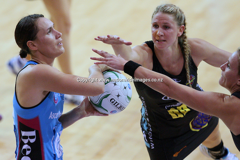 Steel's Jodi Brown looks to attempt a shot at goal while defended by Magic's Casey Kopua and Leana de Bruin in the ANZ netball championship match, Stadium Southland Velodrome, Invercargill, New Zealand, Saturday, May 18, 2013. Credit:NINZ/Dianne Manson